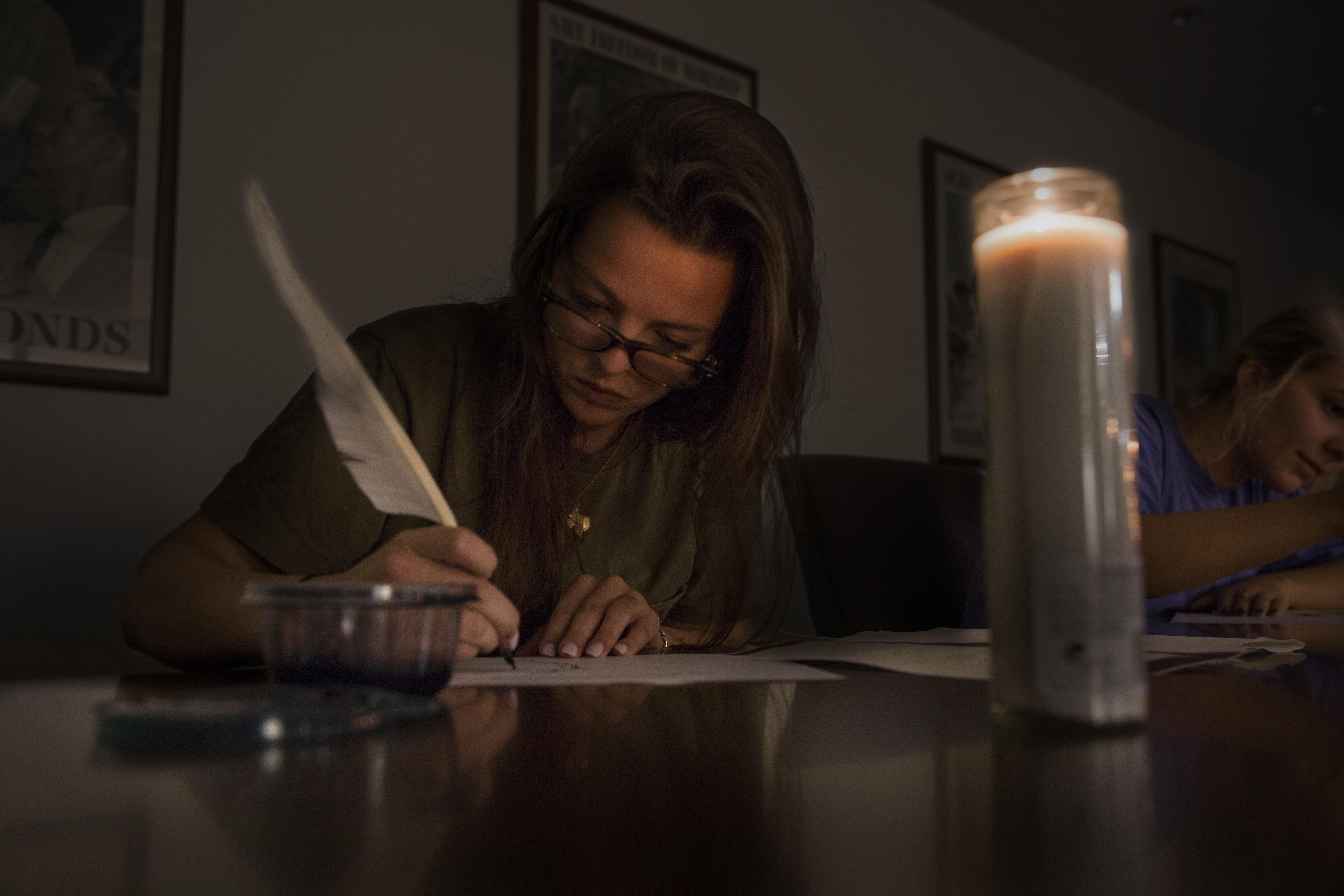 A student writes with a quill
