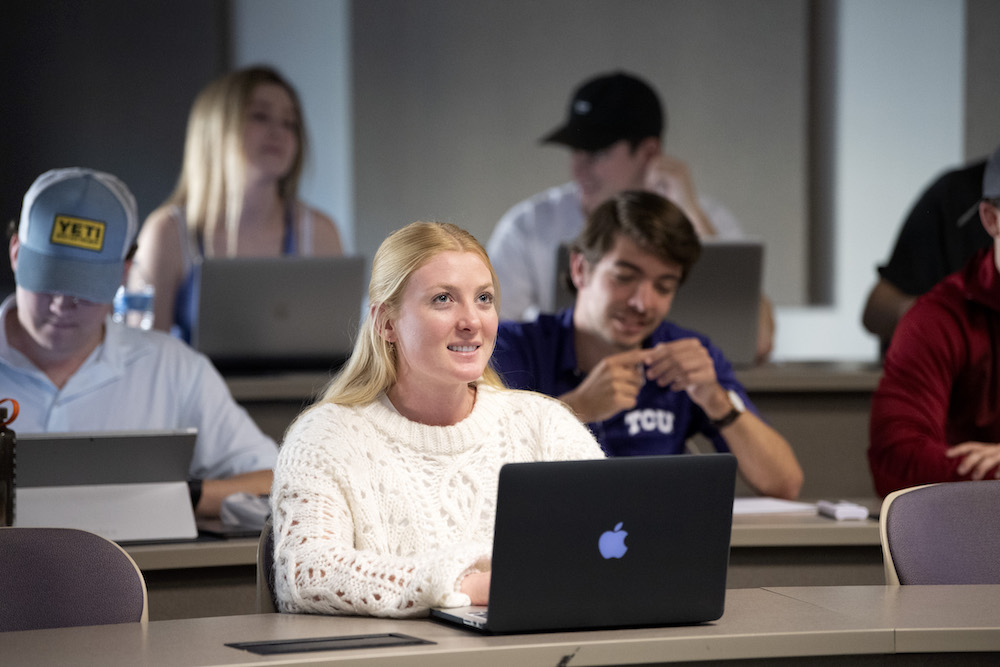 A student smiles during a class