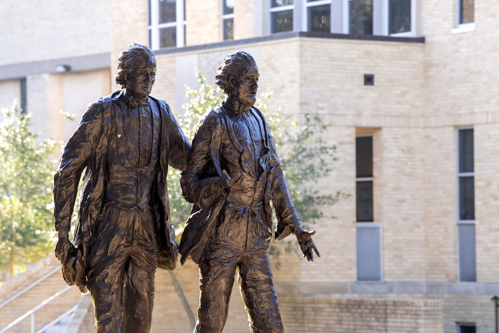 A statue of TCU founders Addison and Randolph Clark