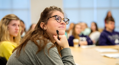 Student listens to professor in lecture