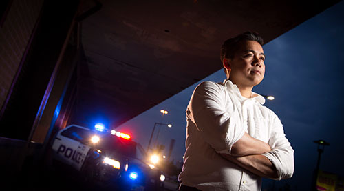 Johnny Nhan, assistant professor of criminal justice in TCU's AddRan College of Liberal Arts, photographed on West Lancaster Avenue in downtown Fort Worth