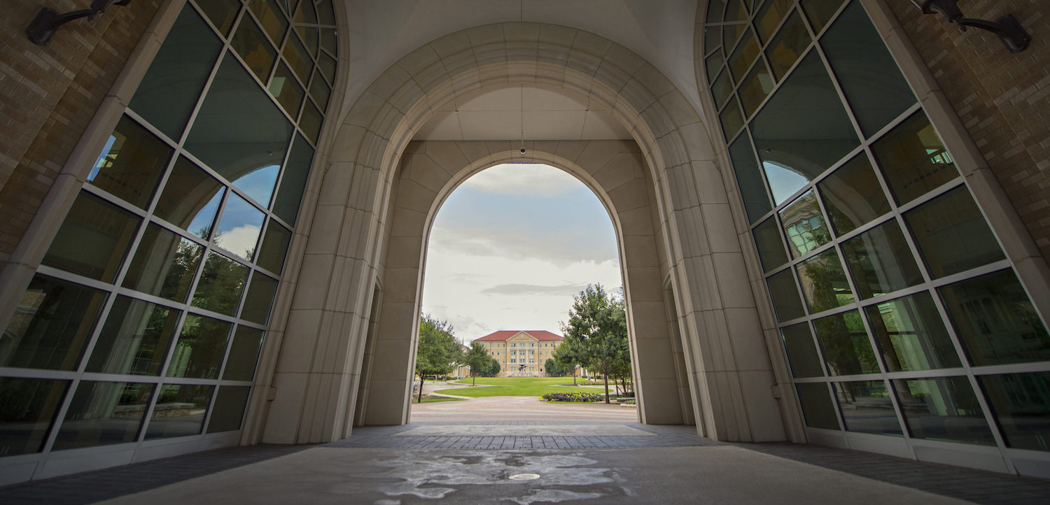 An archway looking into the TCU commons