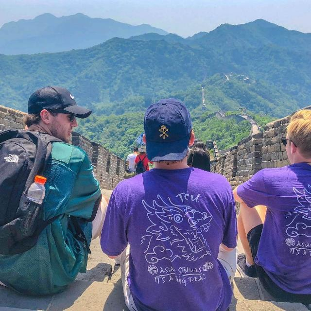 Students sitting on the Great Wall of China